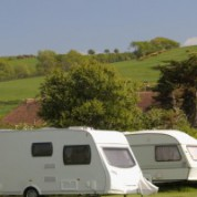 Tourning-caravans-in-field-505x200